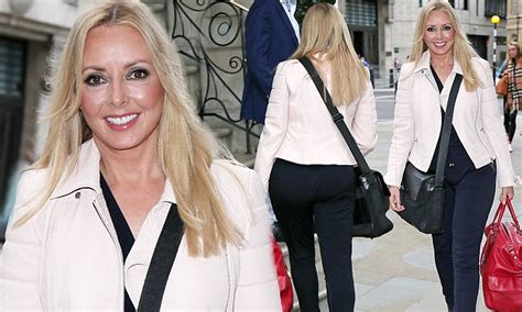 carol has her number 35 carol vorderman highlights her svelte frame in cigarette