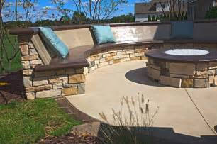 Custom concrete seating bench around gas firepit traditional patio