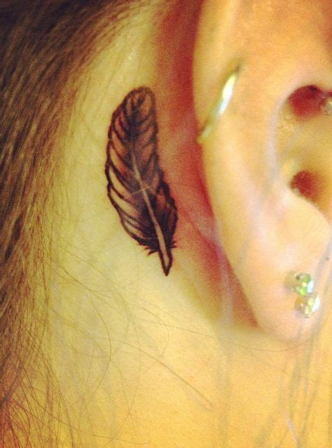 small tattoo behind ear images small black behind the ear feather tattoo