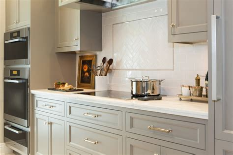 cabinet paint color is river reflections from benjamin moore beautiful warmer gray chelsea honed carrera countertops transitional kitchen