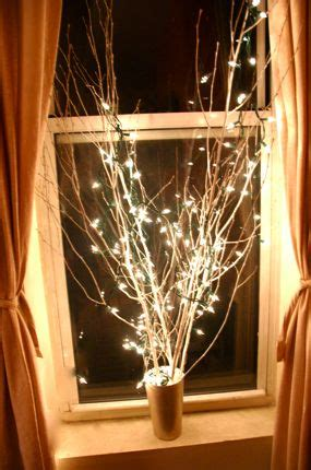 homemade christmas decor branches spray painted white
