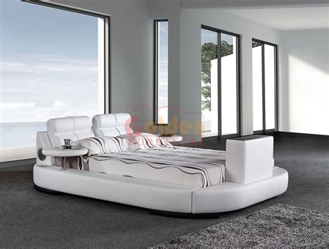 leather bed with tv and stereo in footboard g1031