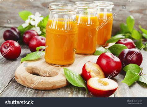 Fruit Juice Fresh Green Plum Juice fresh plum juice on wooden table stock photo 453917407