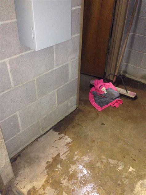 wet basement area in need of waterproofing water on