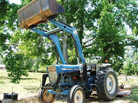 Ford 5000 tractor   loader   bush hog from Surplus on the