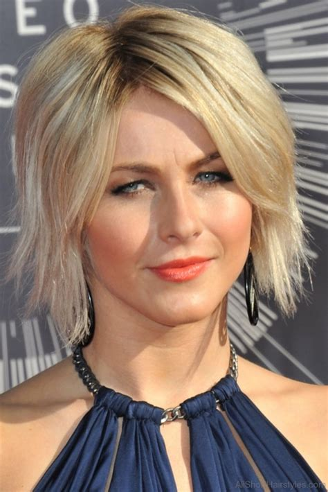 neck length bob with a side swept fringe and an angled parting 40 east short layered hairstyles