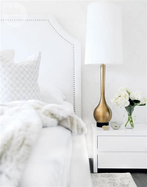 white studded headboard shades of white in a contemporary canadian home