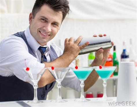 man holding martini what is a hotel steward with pictures