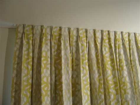 pinched drapes pinch pleat curtains drapes hung above the arch image of