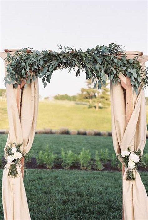 draped wedding arch 35 stunning eucalyptus wedding decor ideas happywedd com
