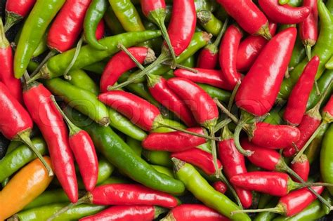 wallpaper of green chillies photo shot of hot peppers background stock photo colourbox