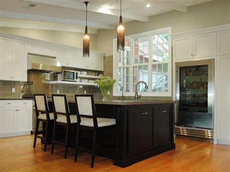 black kitchen island transitional kitchen hgtv in shaker kitchen neutral kitchen with black island and built in