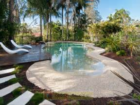 australian garden design using grass with pool