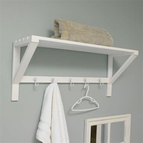 white towel hooks for bathrooms white wall shelf with hooks bathroom storage towel rail