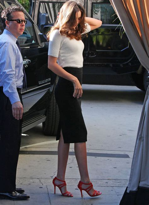 miranda kerr has legs in a pencil skirt and high