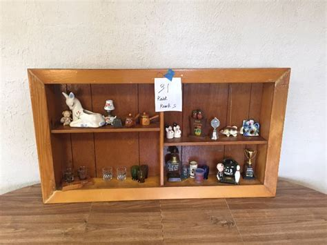 shelf of knick knacks antiques and collectibles