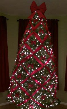 criss cross ribbon with bows on christmas tree how to criss cross ribbons on a tree tree themes