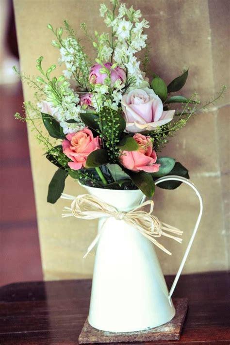 wedding flower jugs 1000 ideas about flowers on bulbs flower arrangements and mexican sunflower