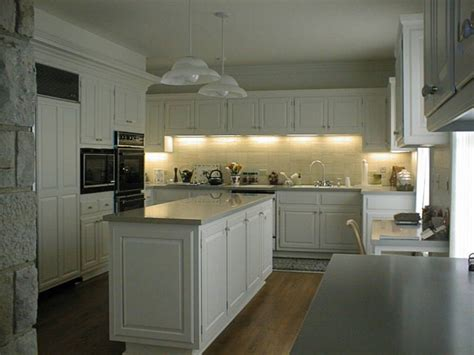 kitchen sink overhead lighting large center island with fountainhead solid surface