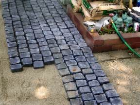 Installing Patio Stones by How To Install A Cobblestone Patio On Concrete Or Bare