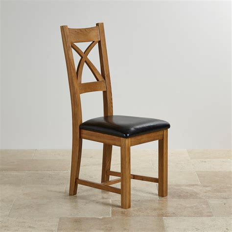 rustic leather dining chairs cross back dining chair in rustic oak black leather