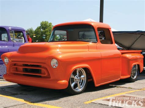 the new chevy orange color truck autos post