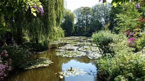 house and garden claude monet house and gardens giverny france visions of travel