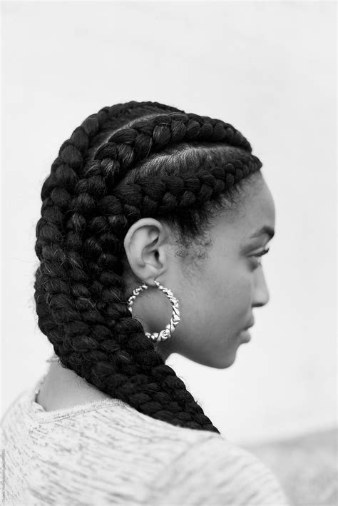 A young african american woman with braided hair by