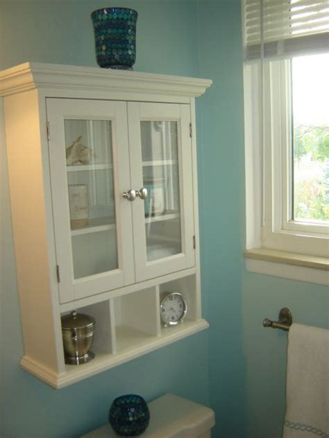 bathroom cabinets above toilet pin by kimberly judy on small bath remodel pinterest