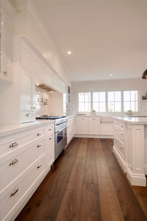 wood floors in kitchen with wood cabinets 7 hardwood flooring trends for your home home bunch