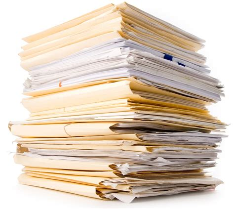 Of Paper - a stack of project papers and folders