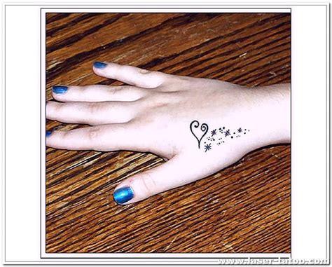 tattoo infinity in hand cross with jw initials tattoo ideas heart tattoo designs