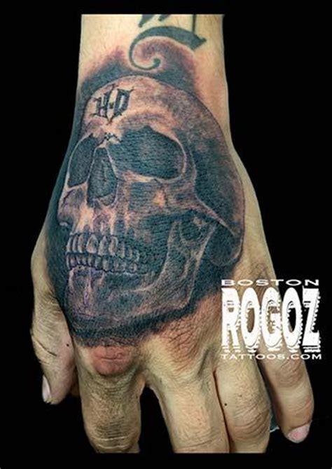 hd hand skull tattoo by boston rogoz tattoos