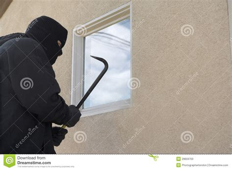 how to break into house burglar breaking into house stock photos image 29659703