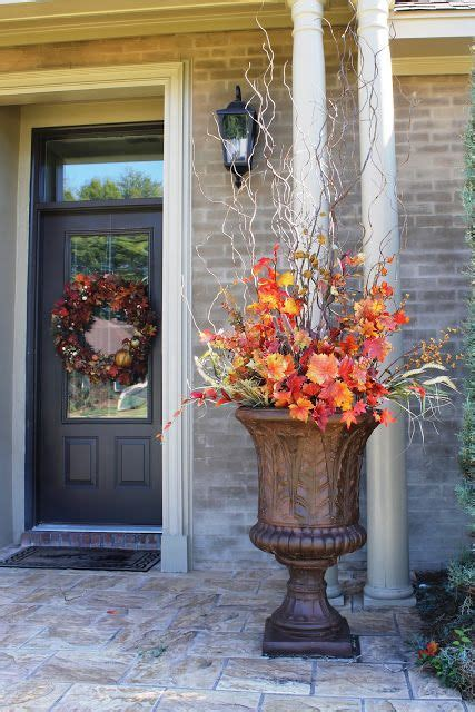 christmas decorating huge stone urns in front of entrance miss kopy fall i fying fall arrangement for urns faux flowers and leaves fall
