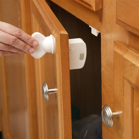 Child Proof Kitchen Cabinets | safety first child proof locks five piece set in cabinet