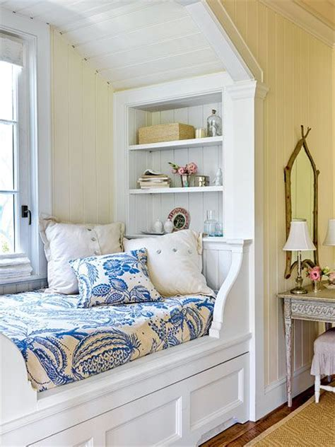 bedroom nook with built in storage and a hidden trundle below this