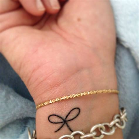 small bow tattoo on wrist small bow i like this bow tattoos