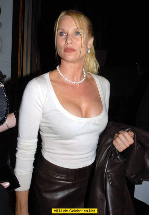 nicollette sheridan shows nicollette sheridan shows deep cleavage when leaving