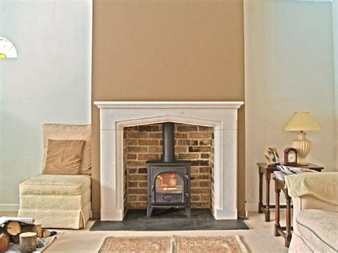 Brick Cladding For Fireplaces by Bespoke Portugese Solid Limestone Mantel With Reclaimed Brick Slip Chamber Slate Tiled