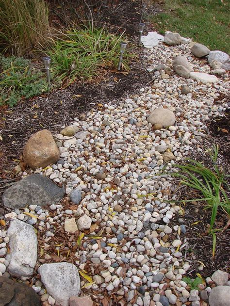 Landscaping With River Rock Dry River Rock Garden Ideas River Rock Garden Bed