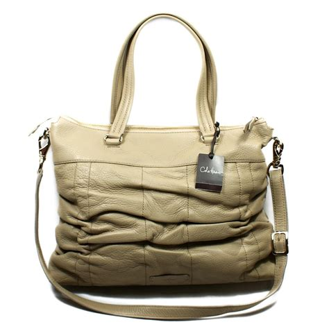 Catania Eastwest Clutch Purses Designer Handbags And Reviews At The Purse Page by Cole Haan East West Zip Light Taupe Leather Tote B37872