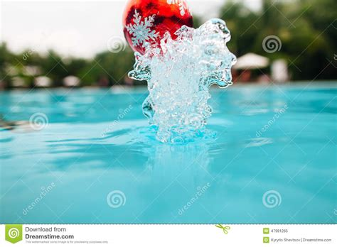 new year water new year tree decoration splash from the water stock photo