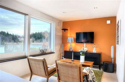 orange accent wall living room bright small living room with orange wall bright small living room with orange wall orange