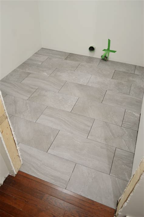 laying porcelain tile   laundry room young house love