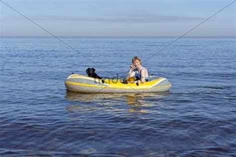 dog on boat to europe woman with dog in a rubber boat kuehlungsborn west
