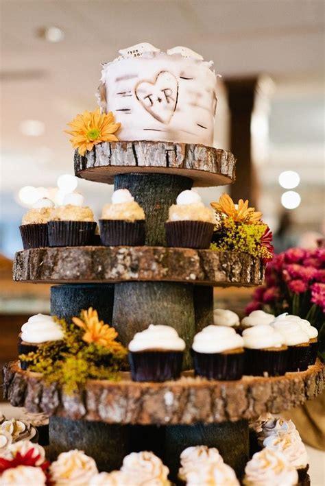 Tree bark cupcake tower with rustic wedding cake tier on
