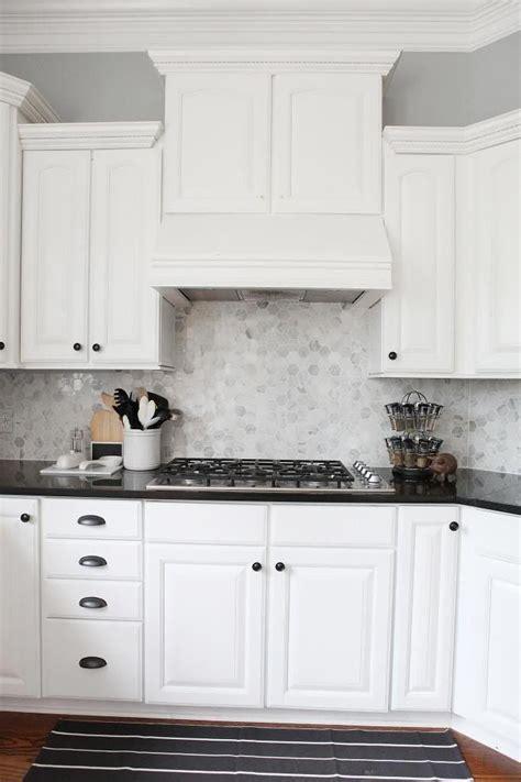 kitchen love  white cabinets  black countertops