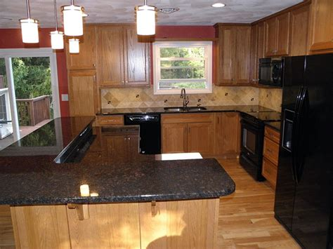 quartz countertops with light oak cabinets oak kitchen cabinets with granite counter top