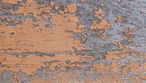 wood background  faded orange paint texture